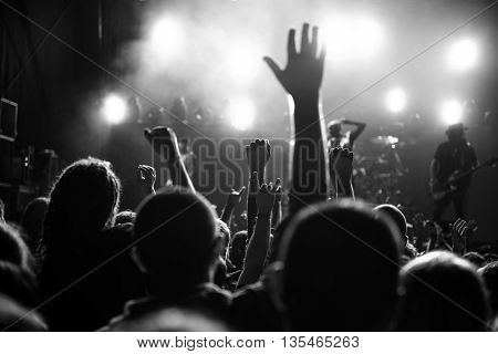 Black and white photo of a music festival crowd.