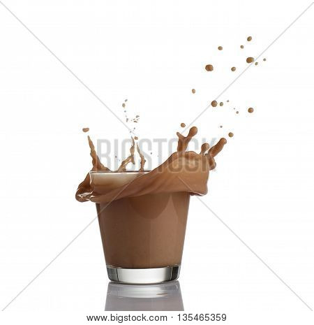Milk chocolate splash isolated over white background.
