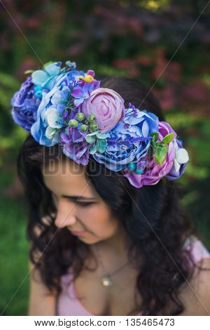 Attractive Young Woman With Blue Flowers Crown
