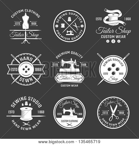 White tailor emblem set with different tools for sewing on black background vector illustration