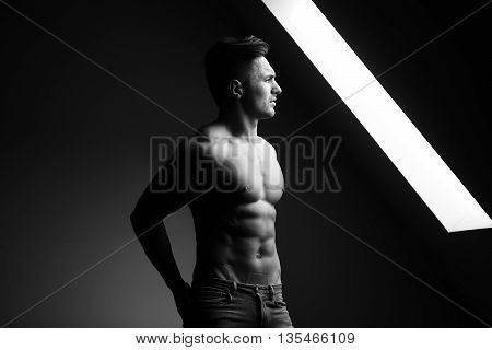 Muscular Man Near Window
