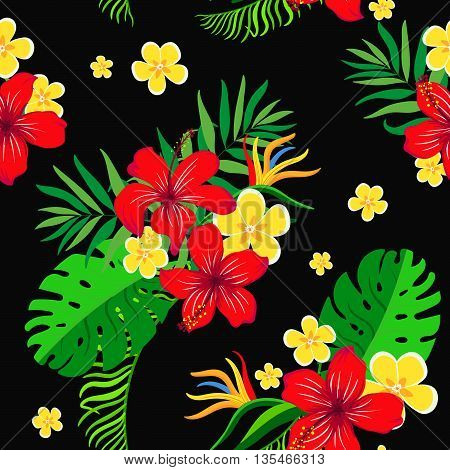 Seamless background with bright exotic flowers on a black background.Tropical pattern for your design.