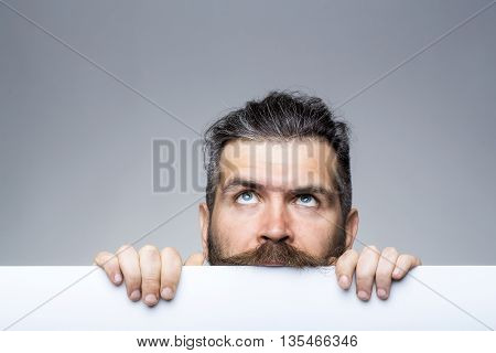 Pensive Man With Paper