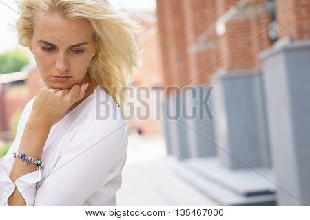 Face emotional expression of sadness. Unhappy worried thinking woman.