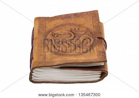 Antique handmade embossed leather book with print in indian eastern oriental style with a print of the Om symbol