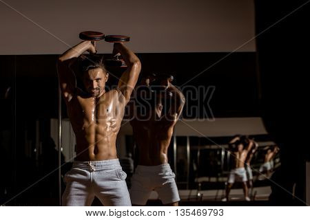 Muscular Man With Dumbbell