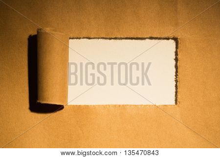 Directly above shot of torn brown paper of box