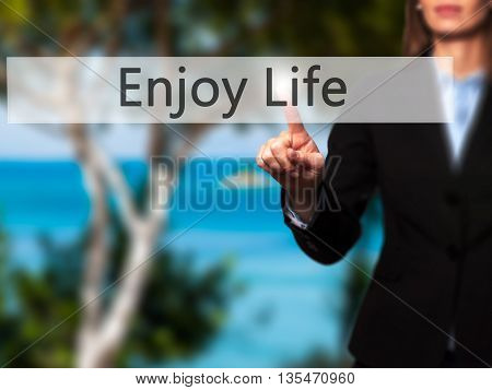 Enjoy Life - Businesswoman Hand Pressing Button On Touch Screen Interface.