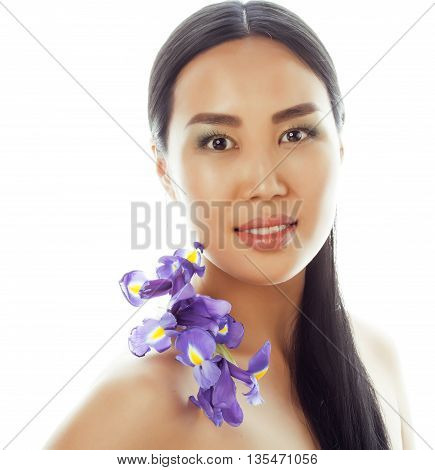 young pretty asian woman with flower purple orchid close up isolated spa smiling