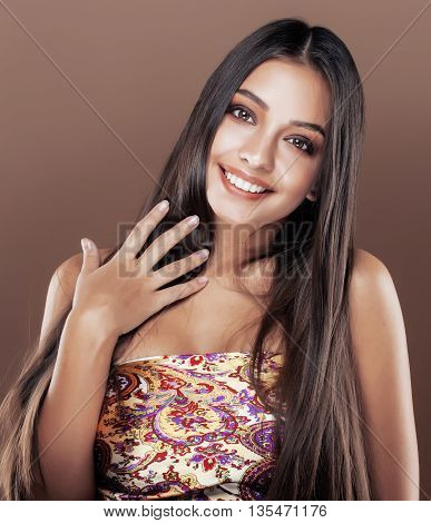 cute happy young indian woman in studio close up smiling, fashion mulatto smiling