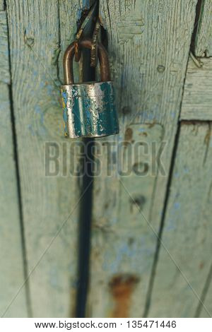 closed old doors hanging and rusty lock