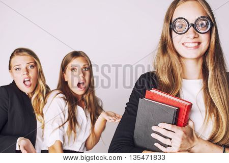 new student bookwarm in glasses against casual group on white, teen drama, lifestyle people