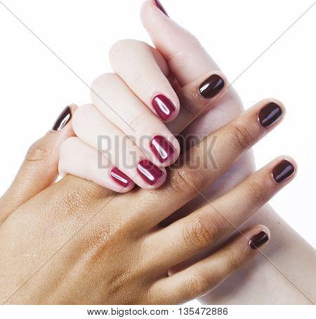 two different nathion manicured hands on white isolated, african with caucasian close up, united nation concept