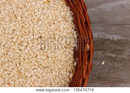 Sesame seed in a punnet on wooden background