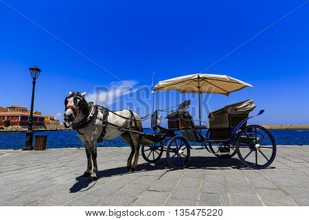 Horse-drawn carriage in the port of Chania, Crete, Greece