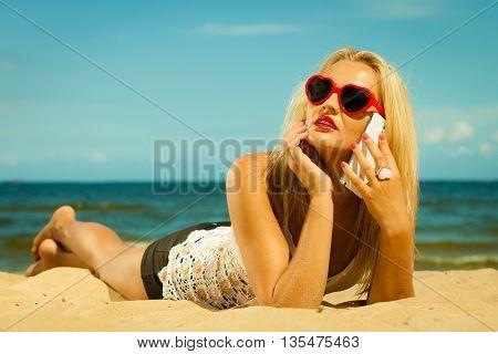 Teen Girl Talking On Mobile Phone On Beach
