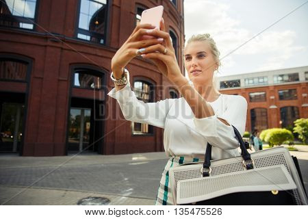 beautiful young girl makes selfie. Toned image