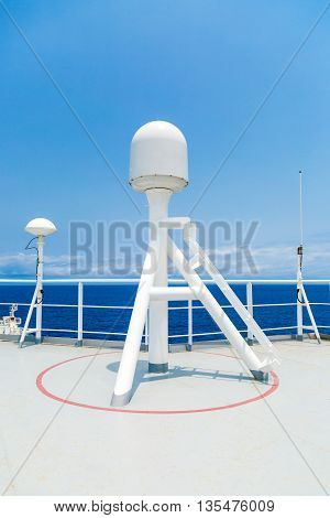Sattelite communication antenna and radar mast of merchant ship.