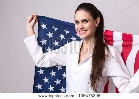 Medicine, pharmacy, healthcare and pharmacology concept, girl holding the USA flag