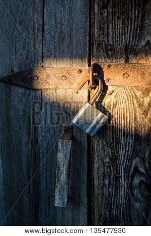old wood door with opened metal lock
