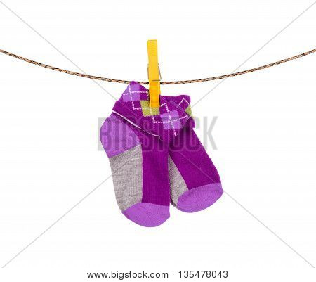 baby socks hanging on a clothesline on white