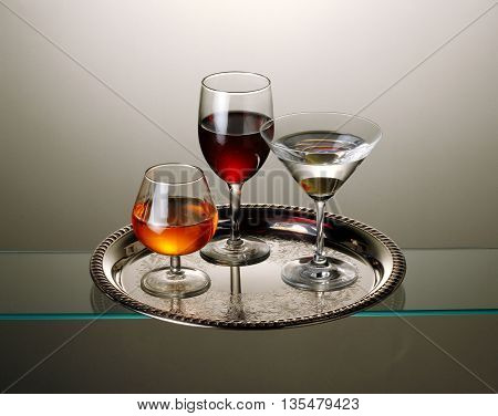 silver tray with three drinks martini wine vermouth