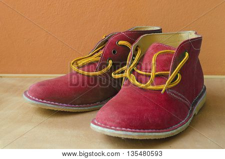 Casual red suede shoes A shoestring yellow A suede classic style luxury Casual accommodation on the wooden floor