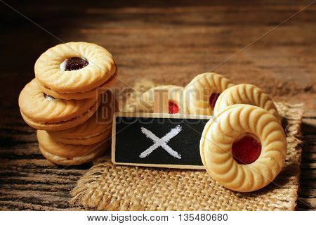cookies with strawberry cream and small wooden concept idea of healthy