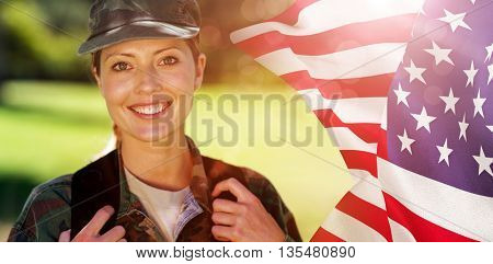 Focus on usa FLAG against happy soldier in the park
