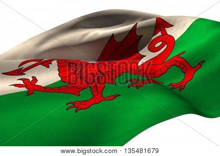 Waving flag of Wales against white background