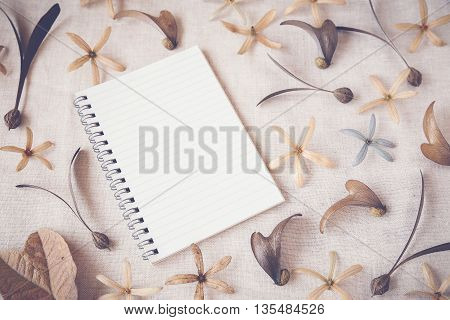 Notebook with flowers and seeds Autumn toning background