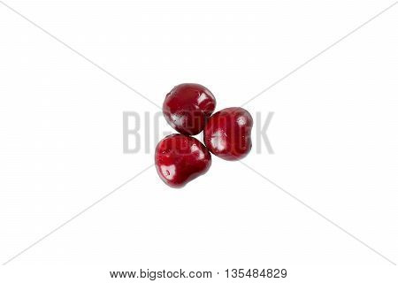 Three sweet and fresh cherry isolated on white background