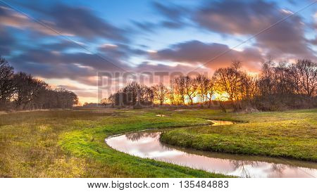 Creek With Blurred Clouds
