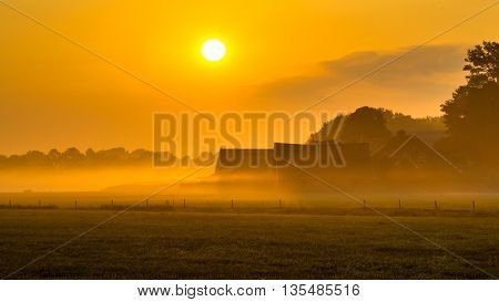 Orange Sunrise Over Dutch Countryside