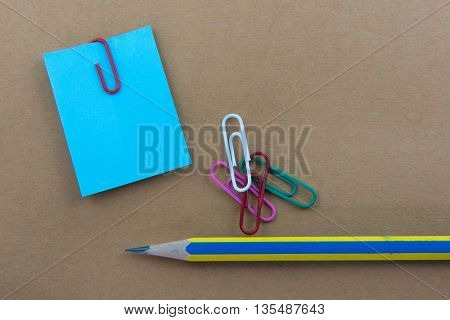 Color  Paper notes with sticky note on brown Background