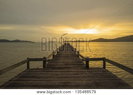 The wood bridge on sunset time in beautiful day, Ranong Thailand