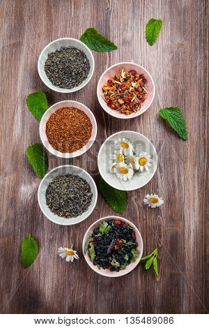Assortment of dry tea in bowls