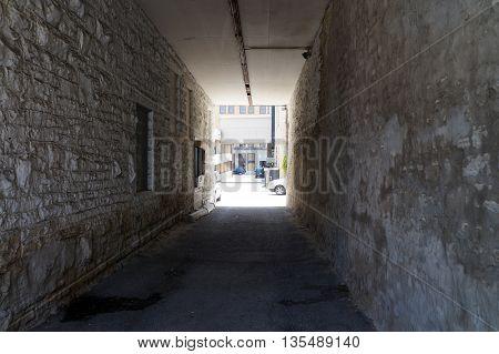 A narrow alley between buildings in downtown Joliet.