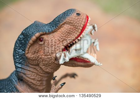 gigantic tyrannosaurus bites a smaller dinosaur in day time