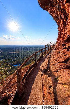 Cliff side wooden bridge at Wat Phu tok temple Bueng Kan Thailand
