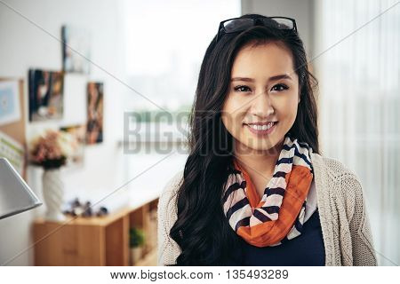Portrait of young pretty girl at office