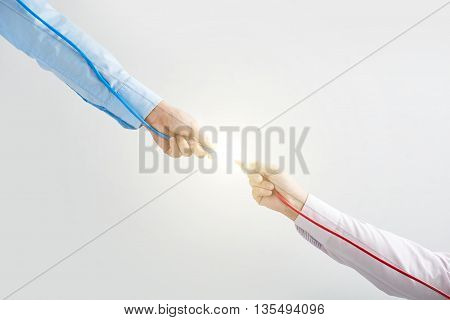 Two men connecting red and blue wires