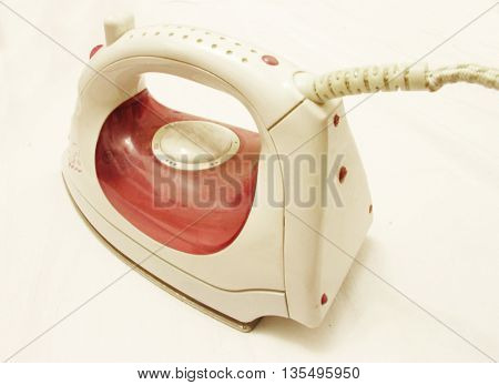 Steam iron isolated on the white background