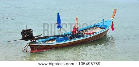 Anchor local long tailed ship waiting for customer in Thailand.