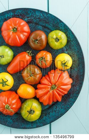 Assortment of fresh French heirloom tomatoes on a platter