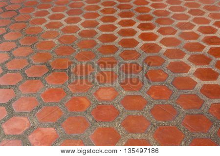 Ceramic tile flooring orange, shooting angle in obliquely.