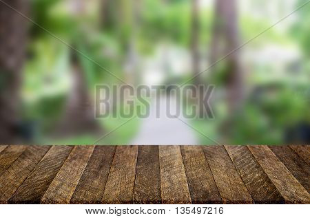 Selected focus empty brown wooden table and for product display montage big wooden table and garden.