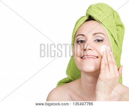 beautiful Young woman dressed in a bath towel makes cosmetic mask on the face. beauty industry and home skin care concept. isolated on white background.