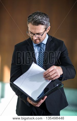 Businessman checking his document in resort