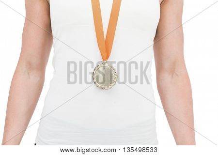 Female athlete wearing a medal on white background
